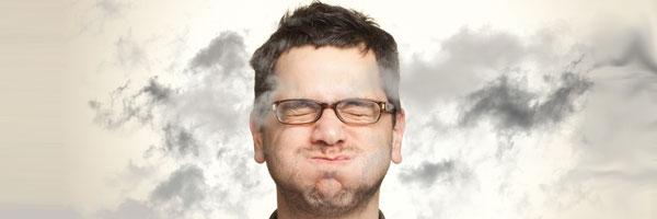 Man holding breath to avoid smoke fumes
