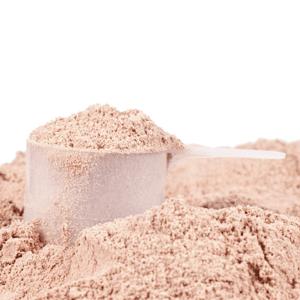 Scoop of casein protein powder