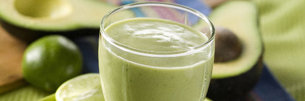 Avocado pineapple smoothie in glass